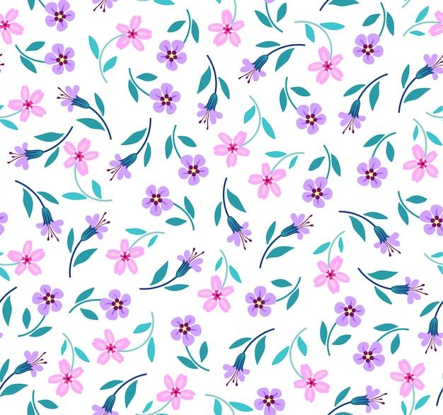 Elegante patrón floral en pequeñas flores lilas y rosas. estilo libertad. floral transparente para estampados de moda.