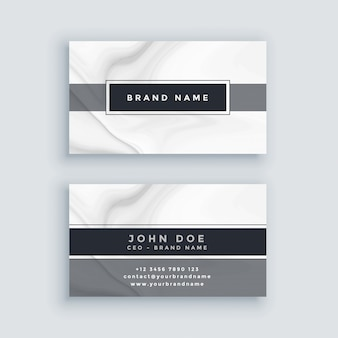 Elegante plantilla de tarjeta de visita gris con fondo de mármol