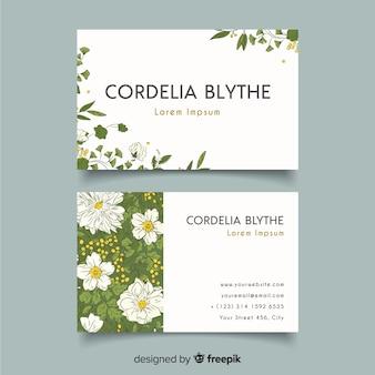 Elegante plantilla de tarjeta de visita con flores y hojas