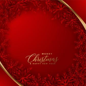Elegante tarjeta de navidad roja con diseño de copos de nieve