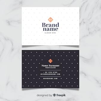 Elegante tarjeta de negocios con lunares
