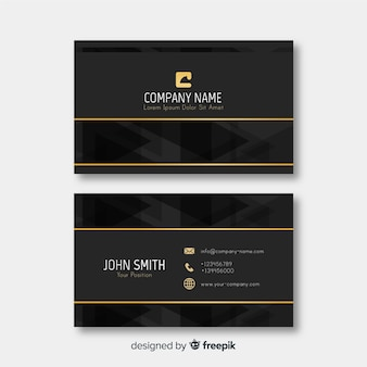 Elegante tarjeta de visita con detalles dorados.