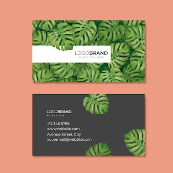 Elegante tarjeta de visita con hojas tropicales