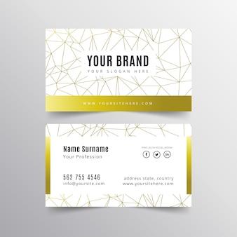 Elegante tarjeta de visita con líneas doradas.