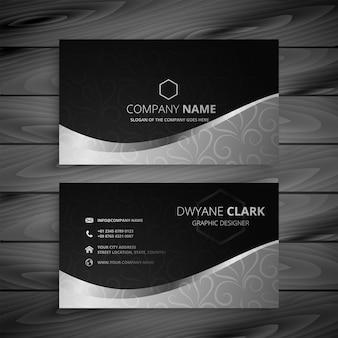Elegante tarjeta de visita en negro y gris.
