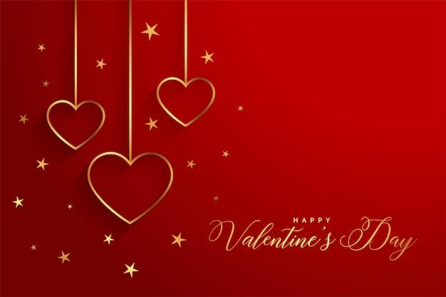 Elegantes corazones dorados en tarjeta de felicitación roja del día de san valentín