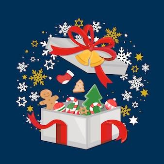 Elementos navideños sobre fondo azul marino oscuro con caja de regalo