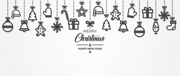 Elementos del ornamento de los saludos de la navidad que cuelgan el fondo.