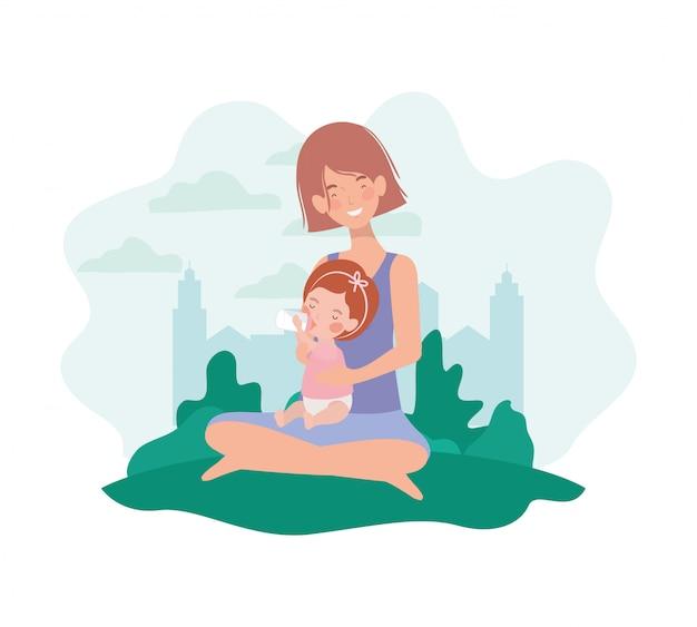 Embarazada linda madre sentada con una niña en el campamento