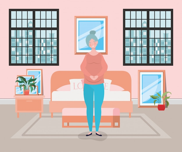Embarazo hermosa mujer en la escena del dormitorio
