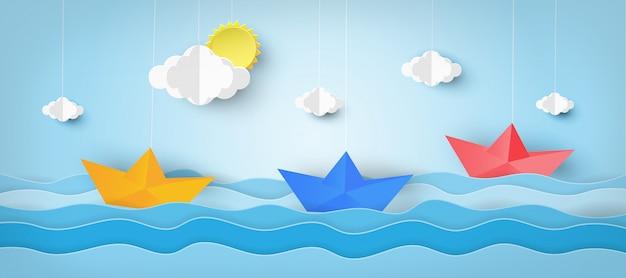 Embarcación realizada en papel con ola de mar.