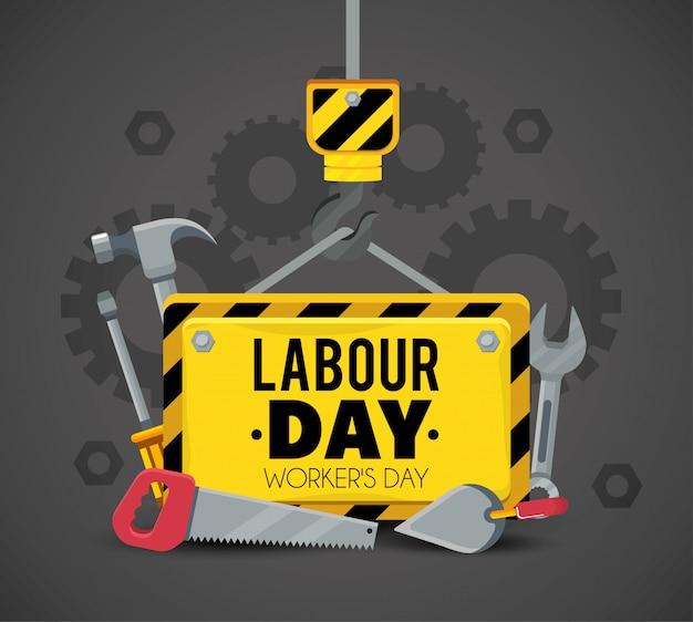 Emblema con herramientas de construcción para vacaciones de trabajo.