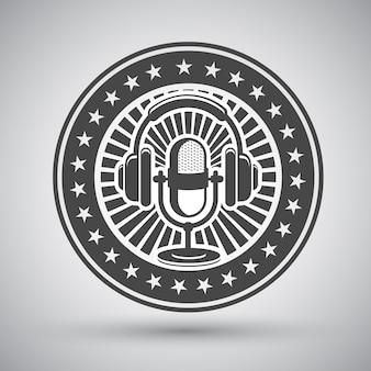 Emblema retro de micrófono y auriculares