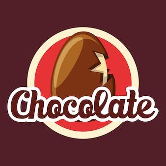 Emblema con roto un huevo de chocolate sobre fondo marrón