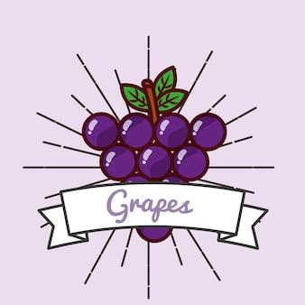 Emblema de vitaminas orgánicas de frutas uvas