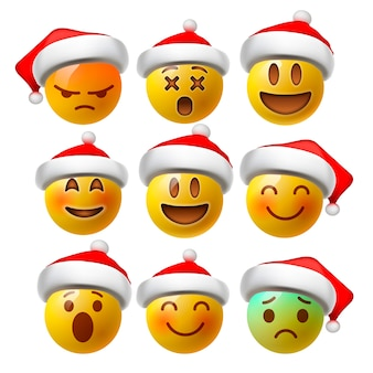 Emoji de cara sonriente navideña o emoticonos amarillos en 3d brillante realista con sombrero de santa
