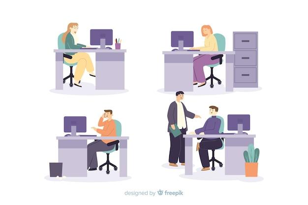 Empleados de oficina sentados en escritorios