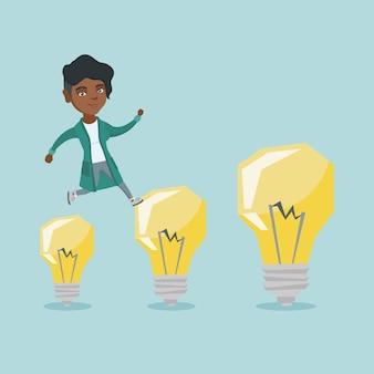 Empresaria africana saltando sobre bombillas.
