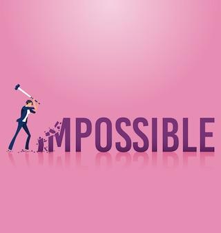 Empresaria destruyendo la palabra imposible a posible