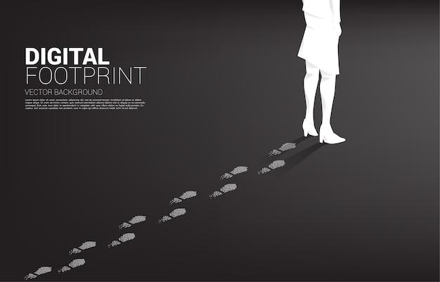 Empresaria con huella de píxel de punto digital. concepto de negocio de transformación digital y huella digital.