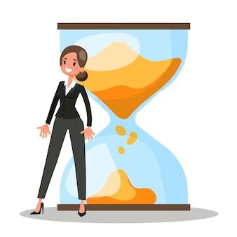 Empresaria de pie en el gran reloj de arena. idea de tiempo