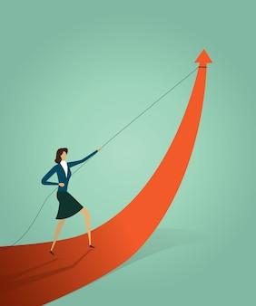 La empresaria que tira del gráfico de la flecha va camino a la meta u objetivo