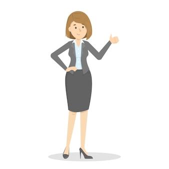 La empresaria en traje de pie y mostrando los pulgares para arriba