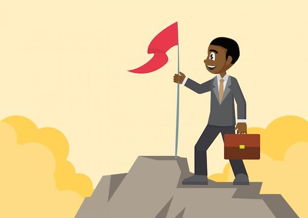 Empresario africano con bandera en la montaña.