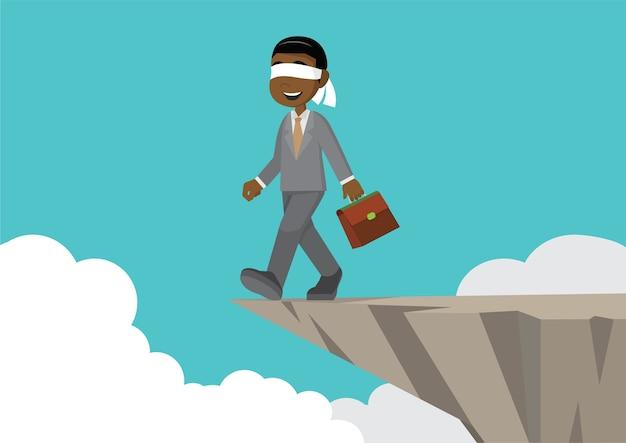 Empresario africano con los ojos vendados caminar hacia el acantilado.