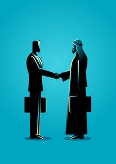 Empresario árabe estrechar la mano con el empresario occidental