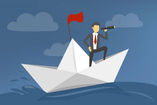 Empresario en barco de papel navegando en el mar