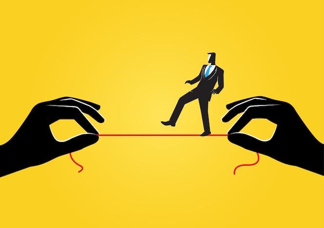 Empresario caminando sobre la cuerda