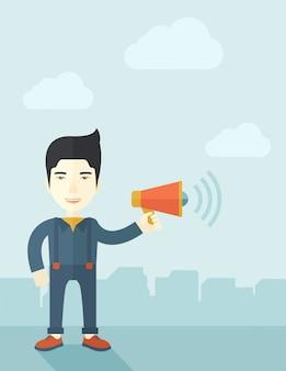 Empresario en el campo con un megáfono.
