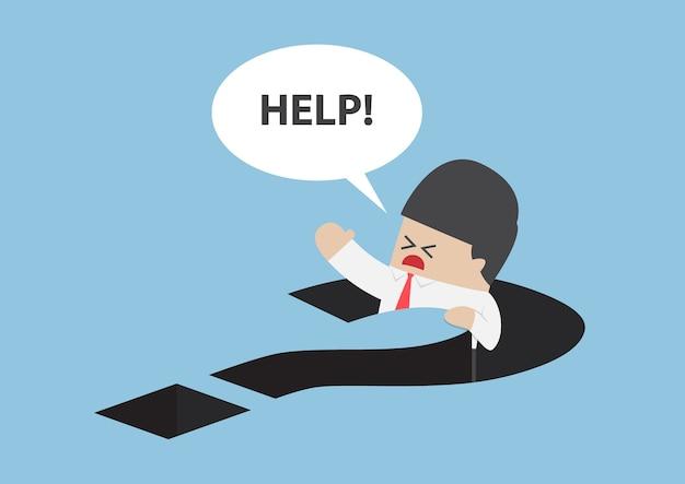 Empresario cayendo en el agujero del signo de interrogación