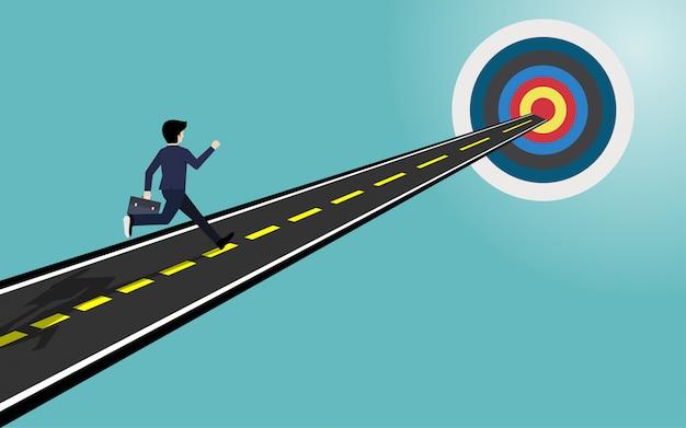 Empresario correr en el camino hacia la meta.