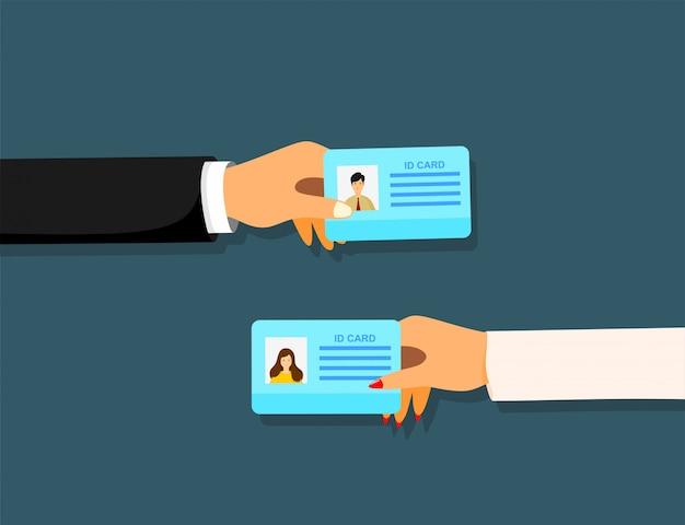 Empresario de dibujos animados mano que sostiene la tarjeta de identificación.