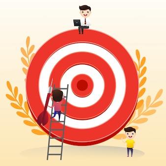 El empresario dirige la flecha hacia el objetivo