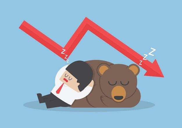 Empresario durmiendo con oso con gráfico de tendencia hacia abajo