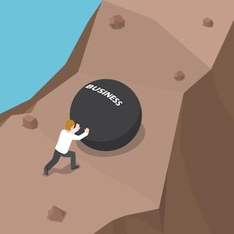 Empresario empujando bola pesada con palabra de negocios cuesta arriba