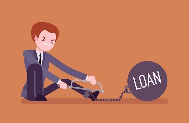 Empresario encadenado con un préstamo de peso metall, aserrado