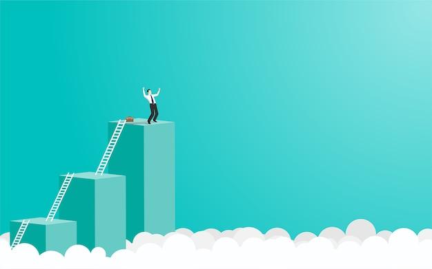 Empresario feliz parado en la parte superior del gráfico