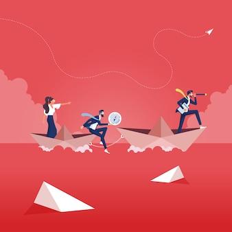 Empresario con monocular en barco de papel como símbolo de liderazgo empresarial
