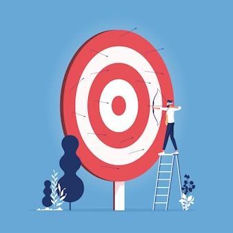 Empresario con los ojos vendados disparando una flecha-perdió el objetivo