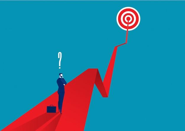 Empresario pensando en flecha roja
