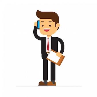 Empresario de pie y hablando por teléfono