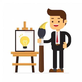Empresario pintando sobre lienzo con idea