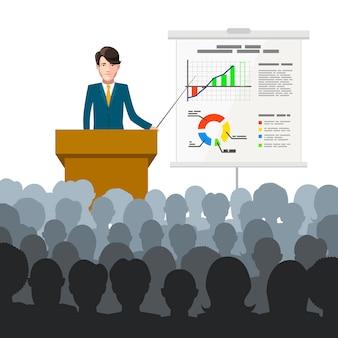 Empresario realiza una conferencia a una audiencia con gráficos de finanzas en cartel