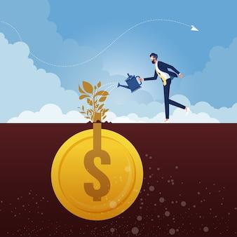 Empresario con regadera regando la planta de dinero