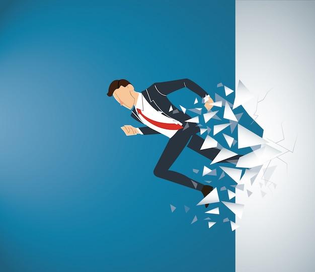 Empresario rompiendo el muro al éxito