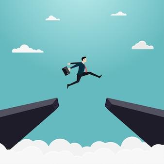 Empresario salta a través de la brecha del acantilado